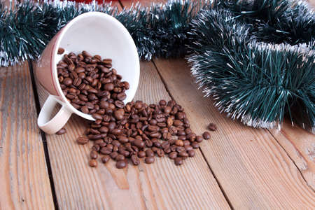 Coffee cup and beans on a wooden table photo
