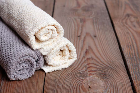 house ware: Rolls of pure towels on a wooden table. Copy space background. Selective focus Stock Photo
