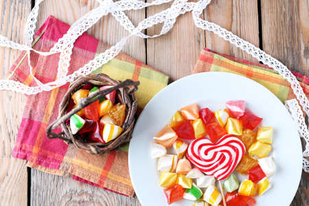 Plate and basket with colorful sweet candies. Selective focus. Traditional Seker Bayram holidays candies