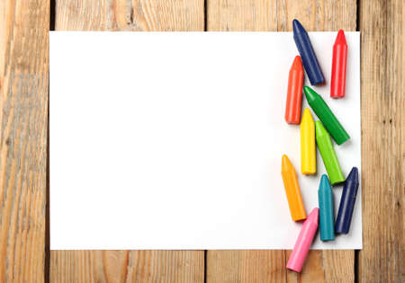 copy space: Crayons lying on a paper. Selective focus, copy space background Stock Photo