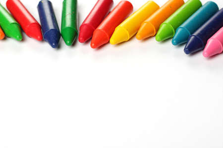 Crayons lying on a paper. Selective focus, copy space background Archivio Fotografico