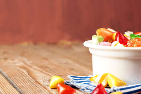 Bowl with colorful sweet candies. Selective focus, copy space background. Traditional Seker Bayram holidays candies Reklamní fotografie