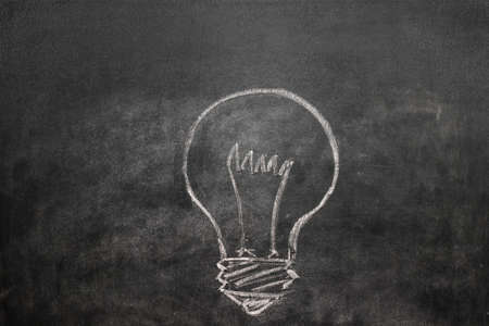 lead sled: Light bulb on a black chalkboard with chalk dust