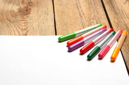 felt tip: Still life, education concept. Felt tip pens on a paper on a wooden table. Selective focus, copy space background