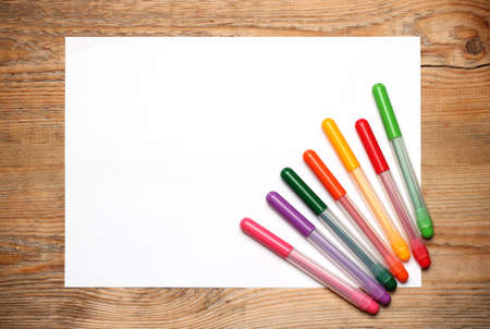 felt tip: Still life, education concept. Felt tip pens on a paper on a wooden table. Selective focus, copy space background, top view