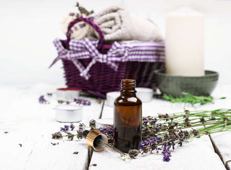 hierbas: Still life, health and beauty, spa concept. Dry lavender and oil  on a white wooden table. Selective focus
