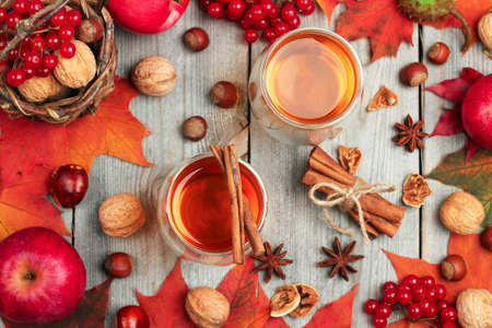 hot drink: Still life, food and drink, seasonal and holidays concept. Autumn hot beverage in a glass with fruits and spices on a wooden background. Selective focus, top view Stock Photo