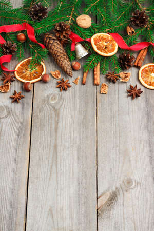 star anise christmas: Still life, food and drink, seasonal and holidays concept. Christmas decoration with fir tree, oranges, cones, nuts, spices on a wooden table. Selective focus, copy space background, top view