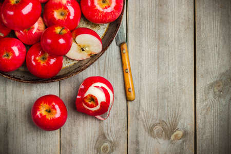 autumn food: Still life, food and drink, seasonal concept. Autumn fresh red organic apples on a rustic wooden table. Selective focus, copy space background, top view Stock Photo