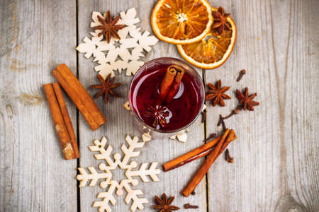 vin chaud: Still life, food and drink, seasonal and holidays concept. Christmas mulled wine on a rustic wooden table. Selective focus, copy space background, top view