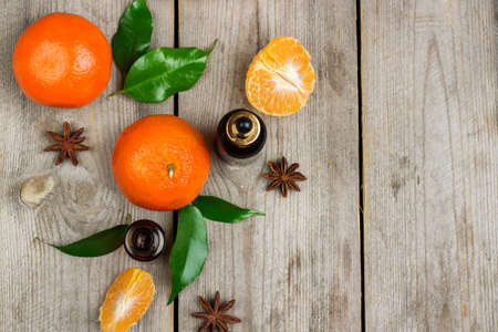 bath supplement: Still life, food and drink, healthcare, beauty concept. Organic tangerine essential oil on a rustic wooden table. Selective focus, top view, copy space background