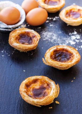 nata: Egg tart on a grunge background, traditional portugueser dessert, pasteis de nata. Selective focus