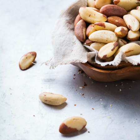 Still life, food and drink, heathy nutrition concept. Portion of organic healthy brazil nuts on a rustic table, selenium source