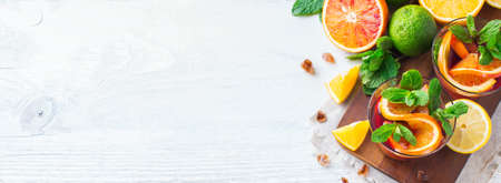 refreshment: Health care, fitness, healthy nutrition concept. Fresh cool citrus lemonade infused water, cocktail, detox drink, beverage for spring summer days. Copy space background, top view flat lay overhead Stock Photo