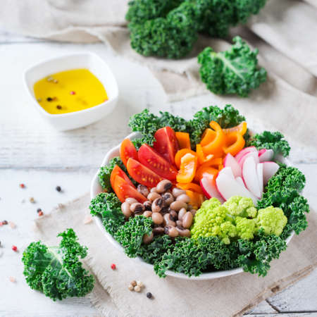 coliflor: Health care, diet and nutrition concept. Buddha bowl with vegetables on a white rustic wooden table, vegetarian vegan raw balanced detox meal food