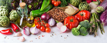 Assortment of fresh organic farmer market vegetables food for cooking vegan vegetarian diet and nutrition on a white table. Top view, flat lay overhead