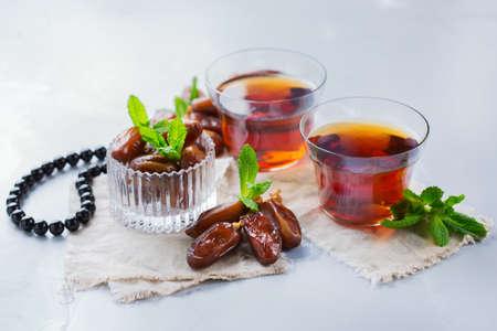 Ramadan ramazan kareem. Traditional arabic tea with mint and dates for iftar party holidays