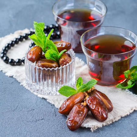 Ramadan ramazan kareem. Traditional arabic tea with mint and dates for iftar party holidays