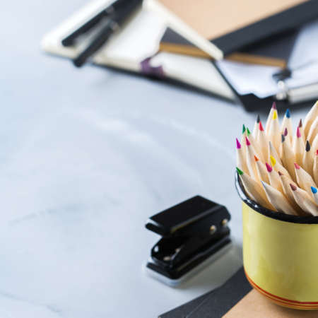 Back to school, business office education concept. Assortment of supplies, crayons, pens, notebook