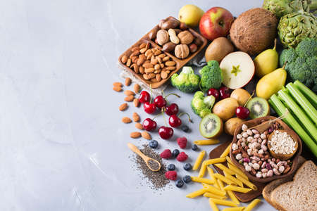 unsaturated: Healthy balanced dieting concept. Selection of rich fiber sources vegan food. Vegetables fruit seeds beans ingredients for cooking. Copy space background, top view