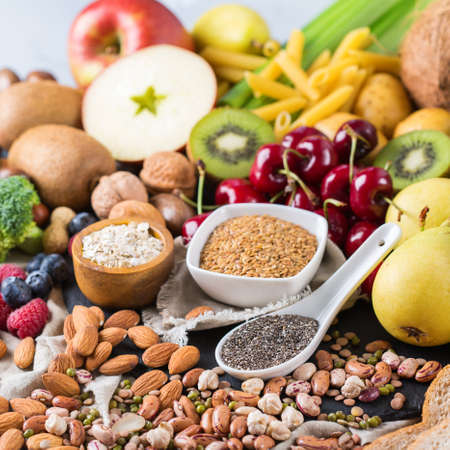 unsaturated: Healthy balanced dieting concept. Selection of rich fiber sources vegan food. Vegetables fruit seeds beans ingredients for cooking
