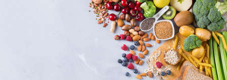 Healthy balanced dieting concept. Selection of rich fiber sources vegan food. Vegetables fruit seeds beans ingredients for cooking. Copy space background, top view