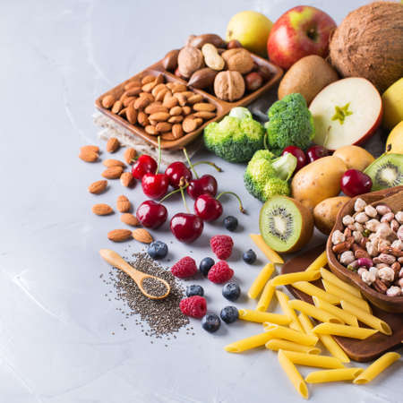 Healthy balanced dieting concept. Selection of rich fiber sources vegan food. Vegetables fruit seeds beans ingredients for cooking