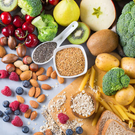 vitamin rich: Healthy balanced dieting concept. Selection of rich fiber sources vegan food. Vegetables fruit seeds beans ingredients for cooking. Top view Stock Photo