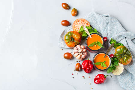 gazpacho: Food and drink, still life, diet and nutrition concept. Seasonal red tomato pepper soup gazpacho with ingredients on a table. Top view flat lay, copy space background