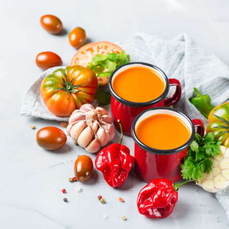 Food and drink, still life, diet and nutrition concept. Seasonal red tomato pepper soup gazpacho with ingredients on a table Stock Photo