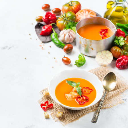 gazpacho: Food and drink, still life, diet and nutrition concept. Seasonal red tomato pepper soup gazpacho with ingredients on a table. Copy space background