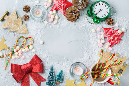 Christmas new year holiday concept. Festive decoration for greeting card with christmas symbols, tree clock star candles. Flat lay top view copy space background Stock Photo