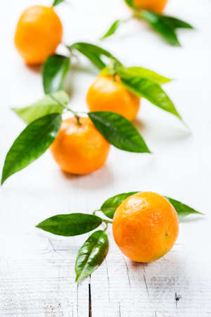 Organic healthy food and drink, vitamin concept. Tangerine mandarine on a white wooden table