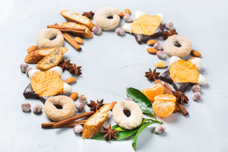 Food and drink, holidays concept. Christmas new year cookies wreath with spices and tangerine. Copy space background
