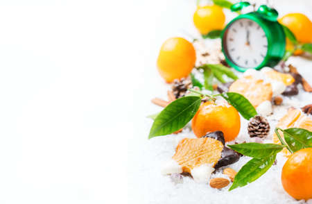 food and drink, vitamin, holidays decoration concept. Christmas new year composition with tangerine mandarine and cookies on a white wooden table. Copy space background