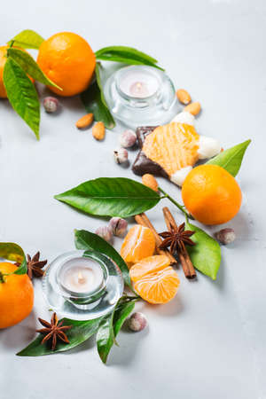 Food and drink, holidays concept. Christmas new year cookies wreath with spices and tangerine o a cozy table