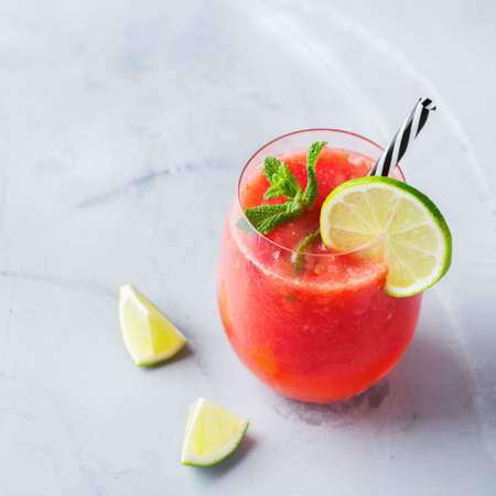 Food and drink, party holiday concept. Alcohol beverage cold cool red watermelon cocktail drink on a modern table for summer days Stock Photo