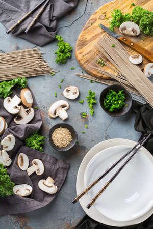 Buckwheat soba noodles soup ingredients for asian chinese japanese korean vietnamese food. Top view flat lay kitchen cooking background 免版税图像