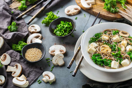 Buckwheat soba noodles tofu soup ingredients for asian chinese japanese korean vietnamese food. Kitchen cooking background