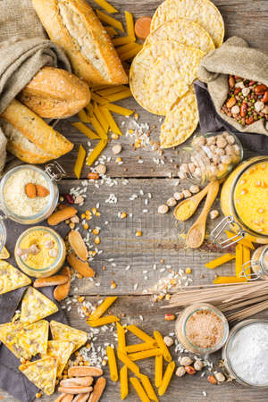 Healthy eating, dieting, balanced food concept. Assortment of gluten free food and flour, almond, corn, rice on a wooden table. Top view flat lay background 写真素材