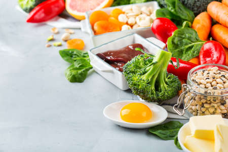 Balanced diet nutrition, healthy clean eating concept. Assortment of food sources rich in vitamin a on a kitchen table. Copy space background Banque d'images
