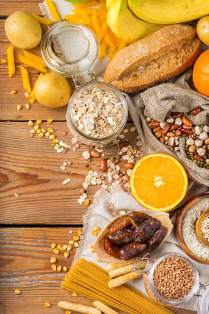 Healthy eating, dieting, balanced food concept. Assortment of gluten free food on a wooden table. Top view flat lay copy space background