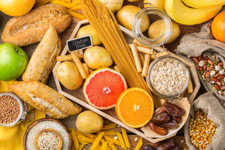Healthy eating, dieting, balanced food concept. Assortment of gluten free food on a wooden table. Top view flat lay background Banque d'images