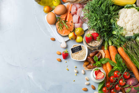 Balanced nutrition concept for DASH clean eating flexitarian mediterranean diet to stop hypertension and low blood pressure. Assortment of healthy food ingredients for cooking on a kitchen table.