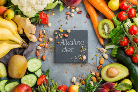 Balanced nutrition concept for clean eating alkaline diet. Assortment of healthy food ingredients for cooking on a kitchen table. Top view flat lay background