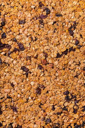 Healthy clean eating, dieting and nutrition, fitness, balanced food, breakfast concept. Homemade granola muesli with ingredients on a table. Top view flat lay background