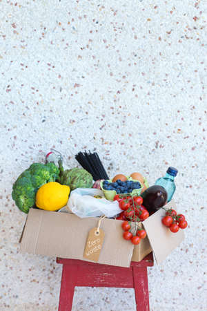 Zero waste no plastic home delivery service. Box of food in recyclable and reusable, eco friendly package near the customer door. Online internet order, shopping. Sustainable lifestyle concept