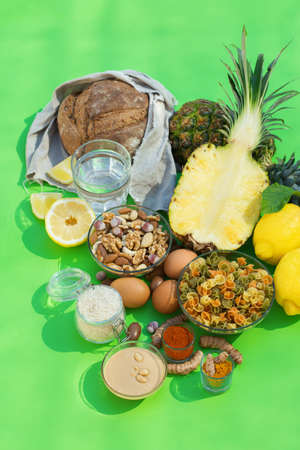 Balanced nutrition concept for low purine eating and diet to stop gout. Assortment of healthy food ingredients for cooking on a kitchen table