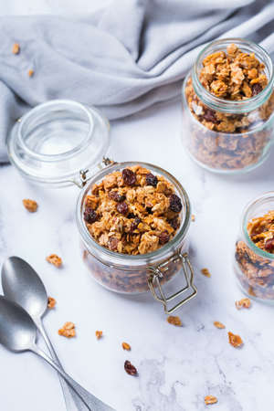 Healthy clean eating, dieting and nutrition, fitness, balanced food, breakfast concept. Homemade granola muesli with ingredients on a table Archivio Fotografico