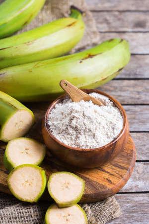Green banana, plantains flour on a table.